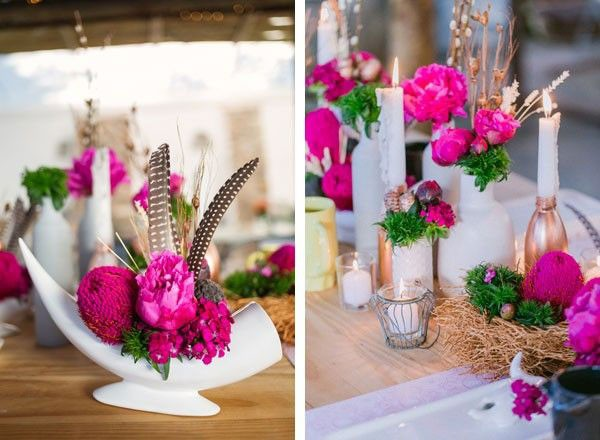 modern bright pink wedding centerpiece with feathers and candles
