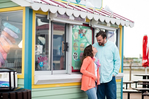 engaged couple standing by Dippin Dots stand