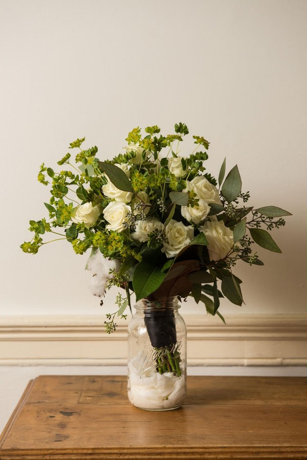 full white rose bridal bouquet with greenery waiting in case