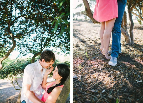 man and woman kiss under tree in Southern California