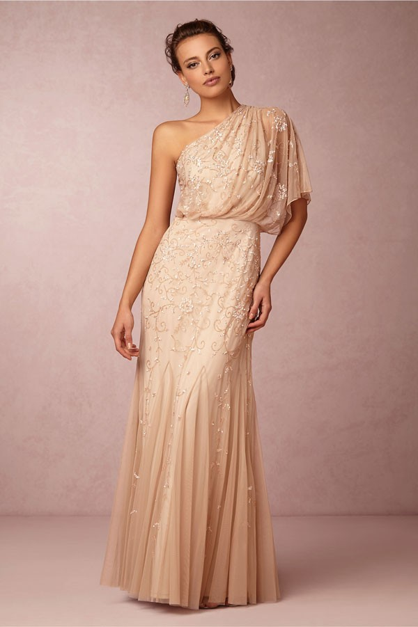 one shoulder champagne wedding dress with sparkly accenting