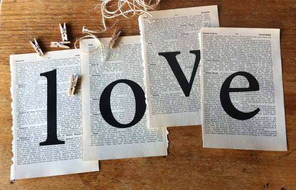 book page love sign hung from mini clothespins