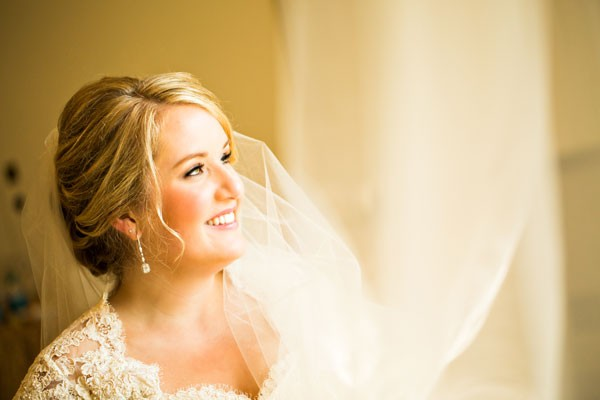 pretty bride with natural makeup and updo with tendrils
