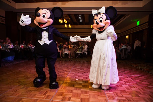 Mickey and Minnie Mouse greet guests on dance floor