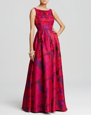 bright, long bridesmaid dress in red and purple floral pattern