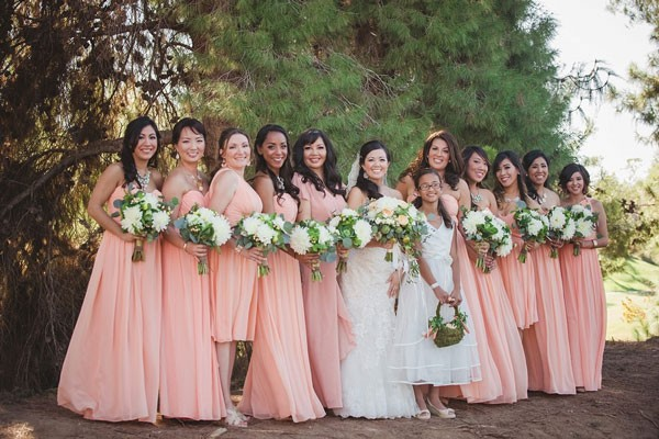 bridal party in pink dresses and white bouquets
