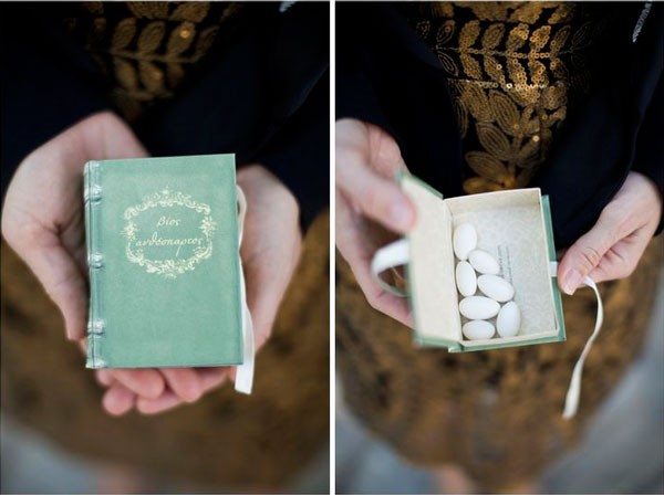 white Jordan almonds as wedding favors in faux book box