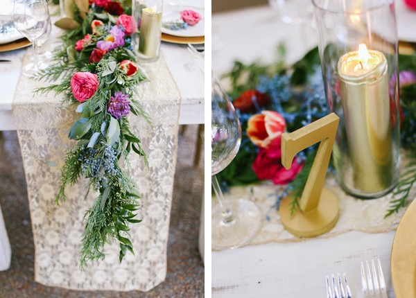 gold table number in front of long flower arrangement featuring tulips, garden roses, and greenery