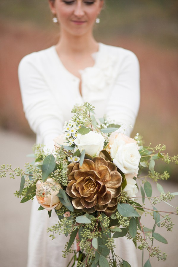 wedding bouquet with large spray-painted gold succulent in center