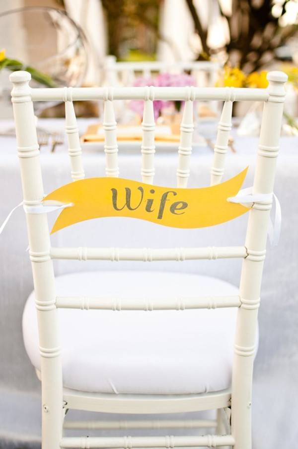 Yellow bride and groom sign