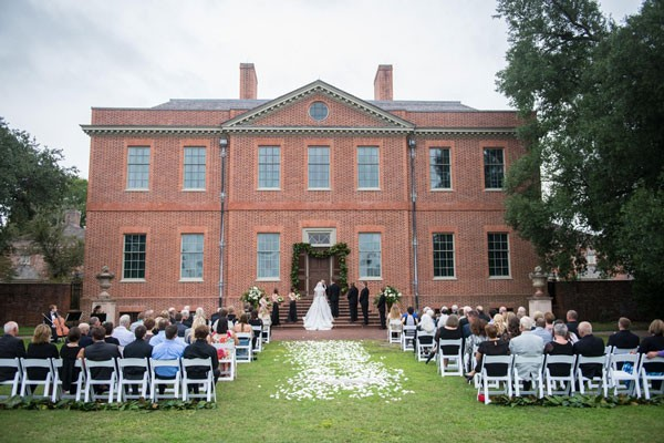 couple gets married on lawn of brick estate