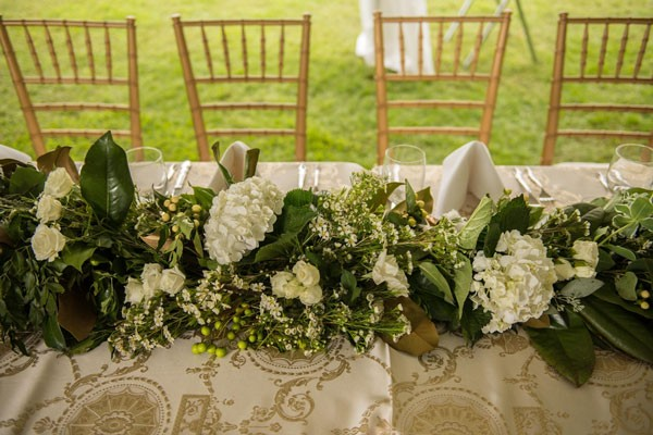 reception centerpiece with white hydrangeas and white roses