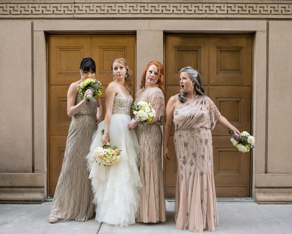 silly bridal party making funny faces in Art Deco inspired gowns