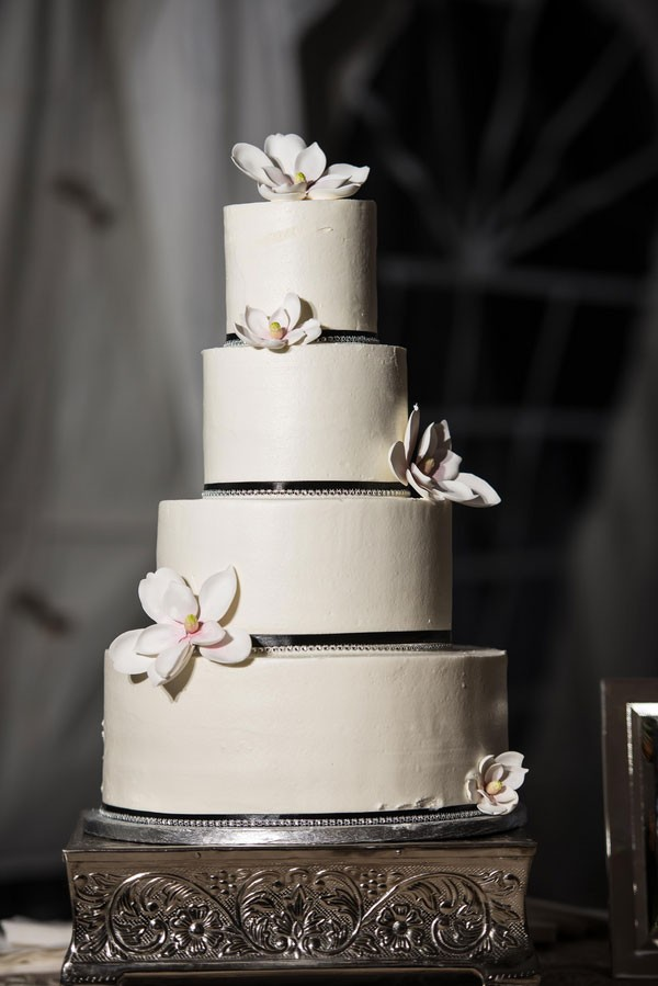 simple white wedding cake with floral decor