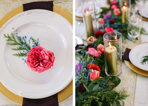pink garden rose on top of plate and long floral centerpiece with gold candles