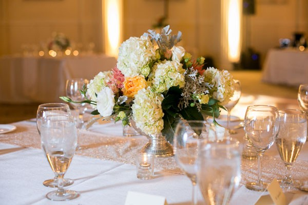 white hydrangea and bright rose centerpiece