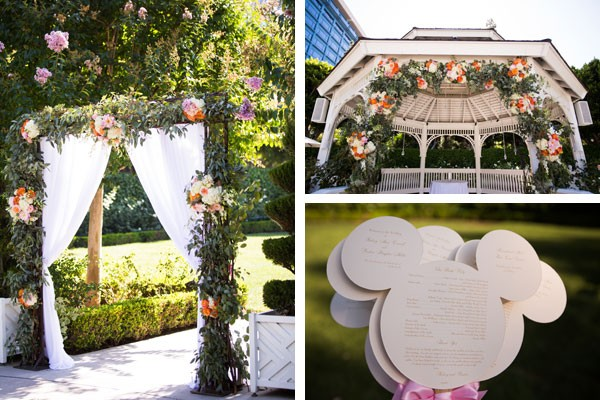 Disneyland wedding details including Mickey Mouse shaped program and floral ivy arch