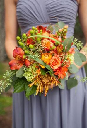orange bridesmaid bouquet with eucalytptus