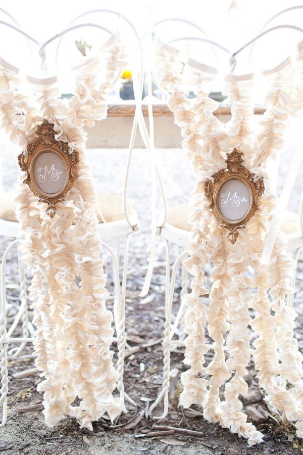 Ruffled paper wedding chair signs