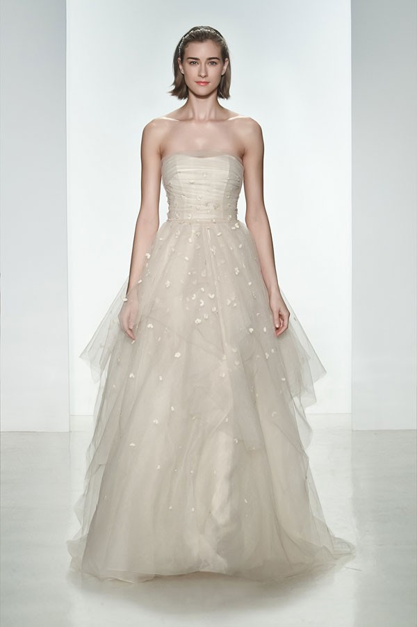 wedding dress with defined waist and lingerie inspired bodice wrapped with a thin layer of tulle