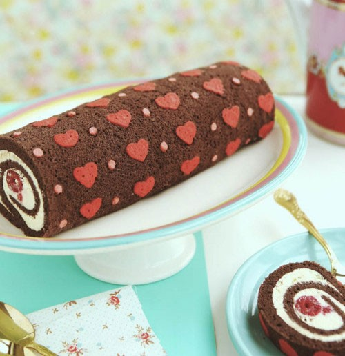 cake roll with red and pink hearts