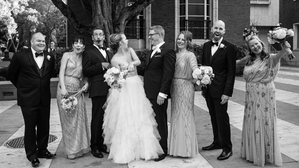 wedding party makes comical faces and poses for camera