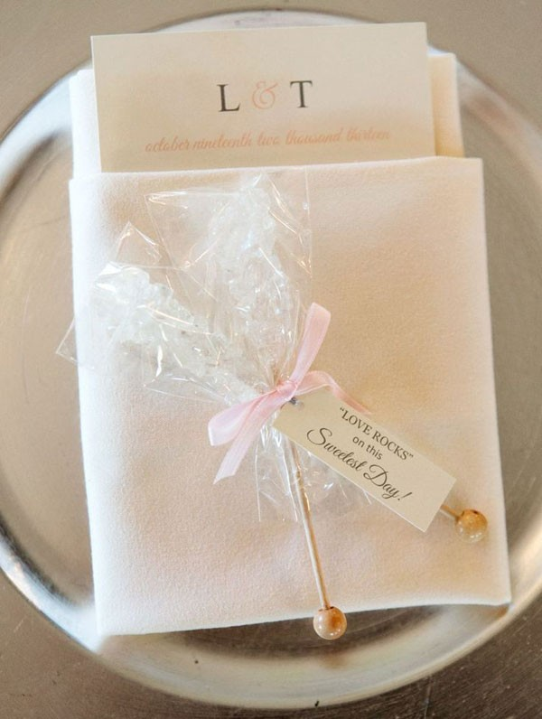 rock candy favor on white napkin place setting