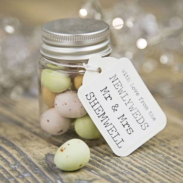 candy eggs in small jar with personalized tag for wedding favor
