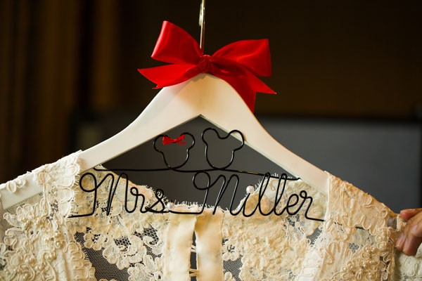 Disney themed hanger for wedding dress with red bow and black Mickey Mouse silhouette