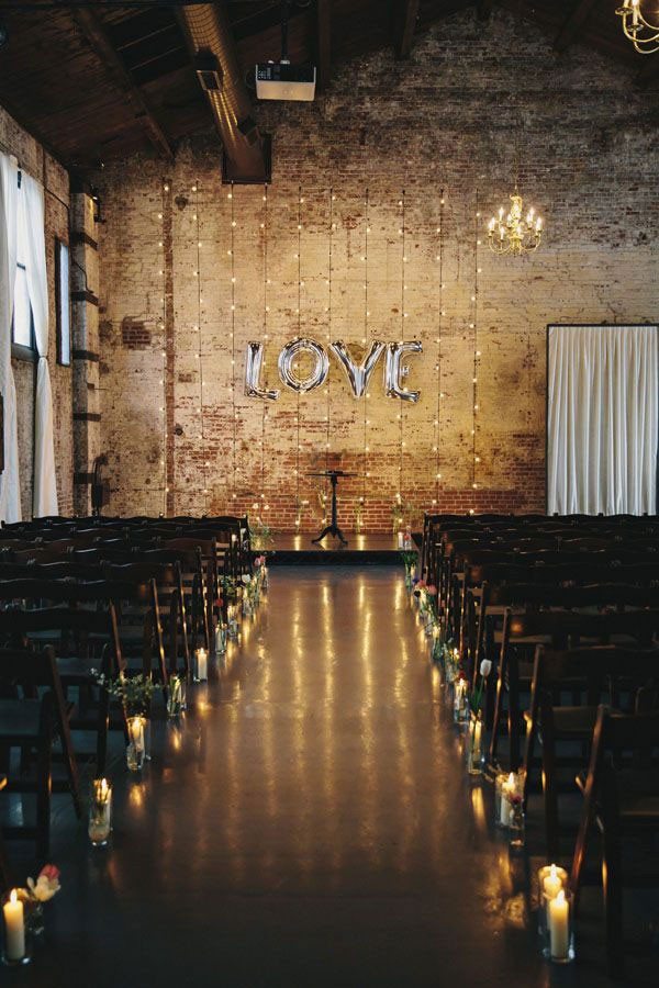 mylar balloons spelling out love at altar backdrop