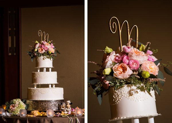 traditional buttercream wedding cake with floral topper and gold monogram