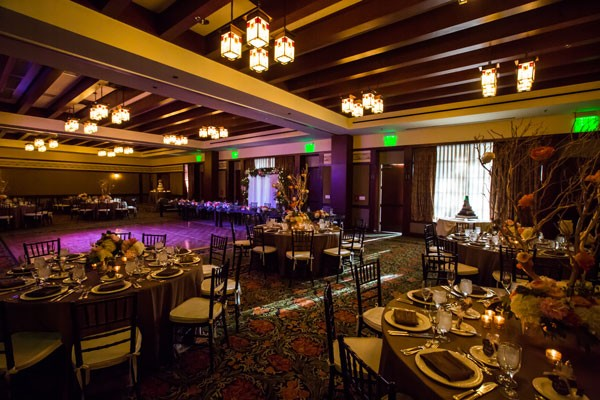 traditional hotel ballroom wedding reception with Craftsman style light fixtures