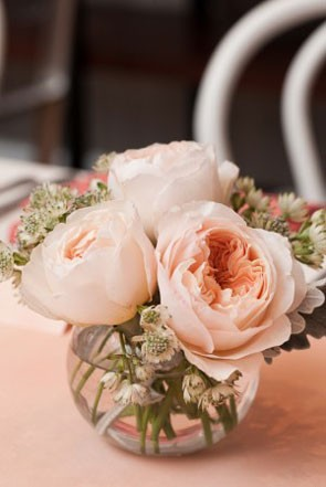 pink wedding centerpiece with peonies in small round vase