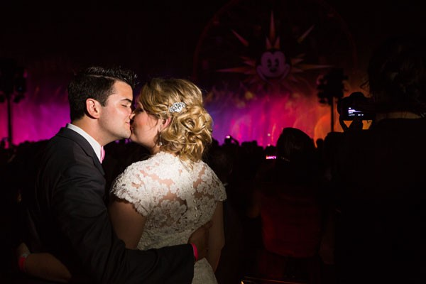 bride and groom kiss before Disney California light show
