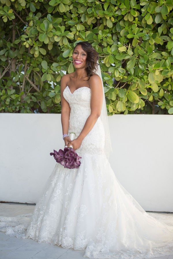 bride in fit and flare wedding dress with strapless sweetheart neckline