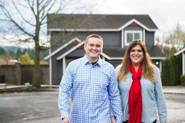couple walking in Portland neighborhood for engagement session