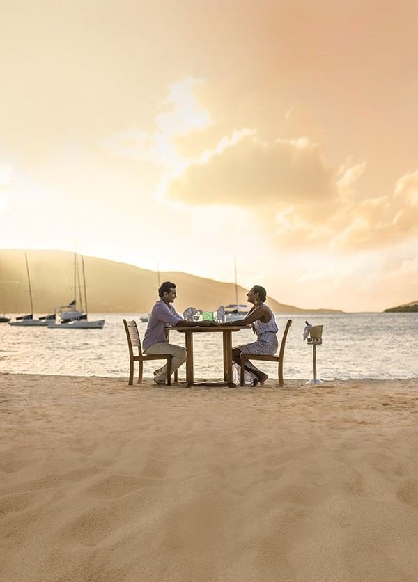 couple eating on beach in British Virgin Islands