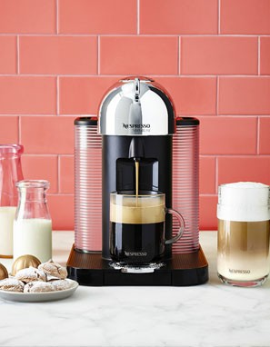 Nespresso coffee maker with breakfast foods