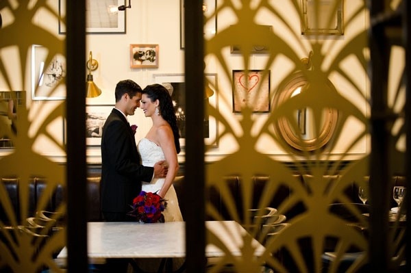 couple behind divider with Art Deco pattern