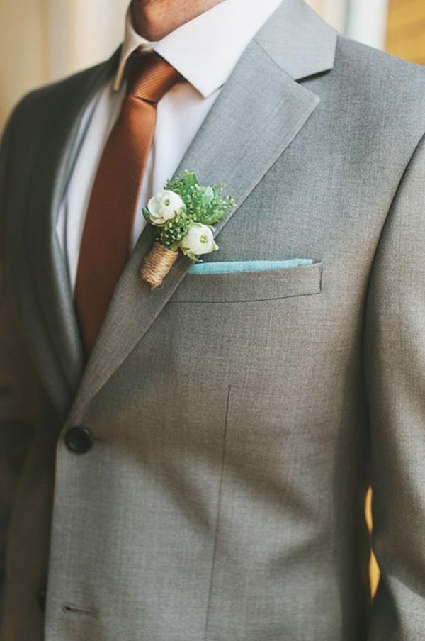 Groom with grey suit and copper tie