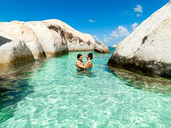 couple in aqua waters in British Virgin Islands
