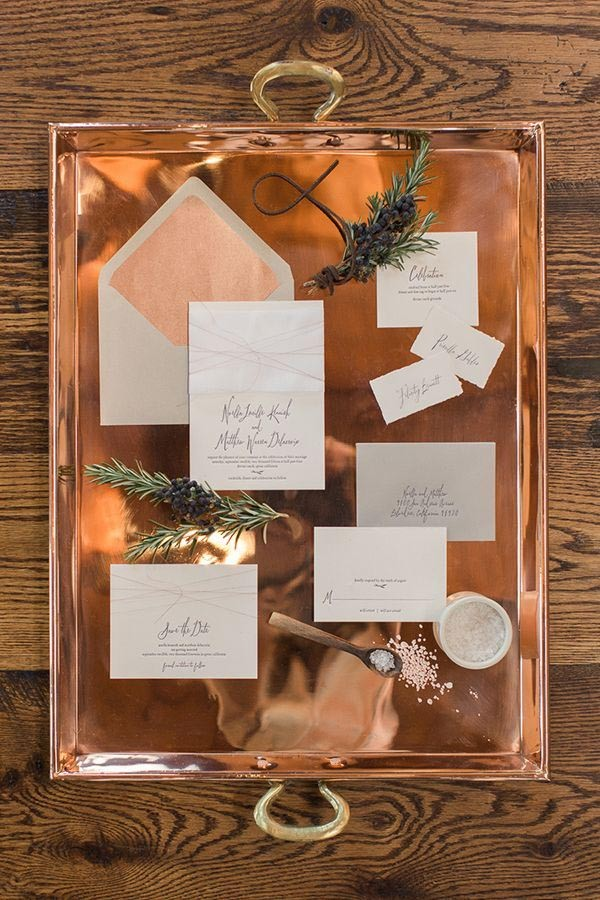 Copper tray and neutral wedding invitation suite