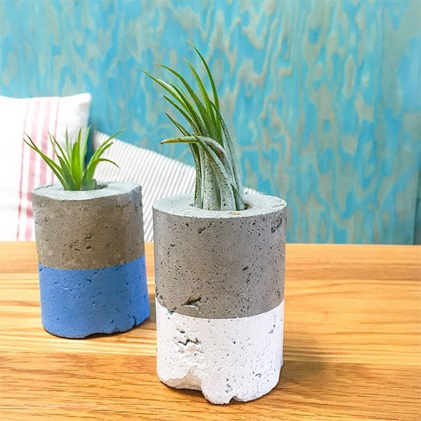 Concrete vases for table centerpieces